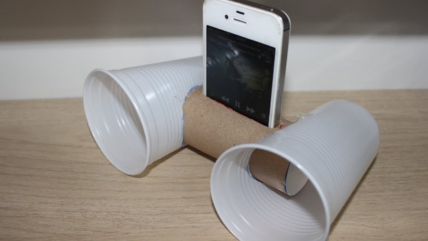 A makeshift audio amplifier using cups and a cardboard roll. This is an example of creativity by overcoming functional fixedness.