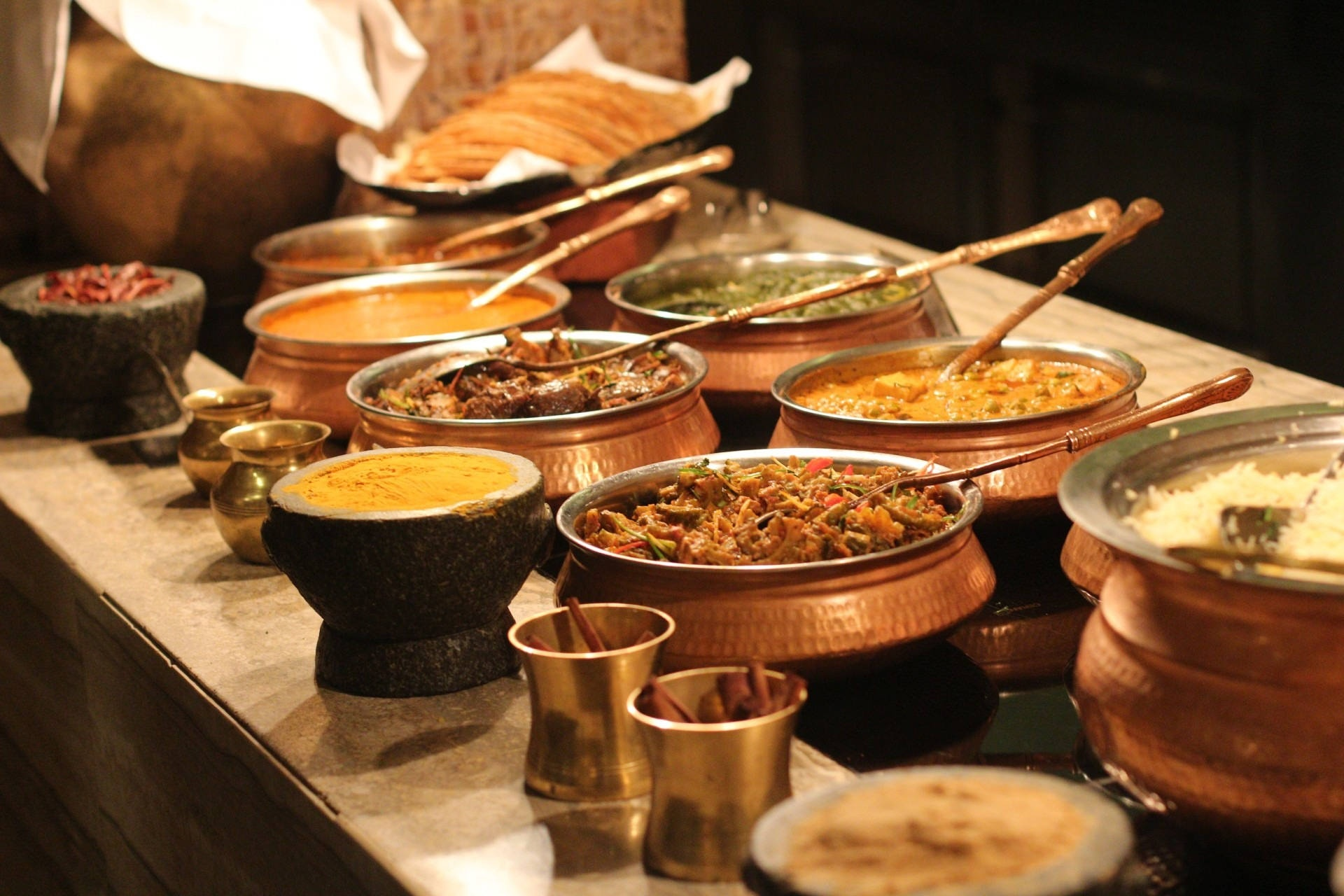 Indian food served daal, rice, vegetable and spices shown