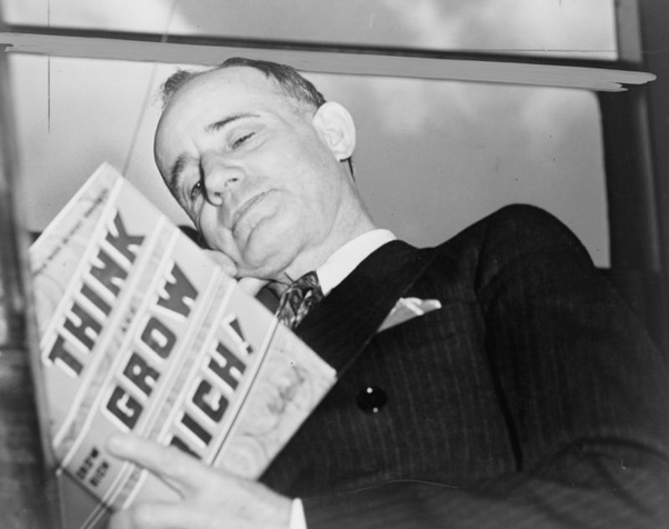Napoleon Hill - The Author of Think of Grow holding his own Book